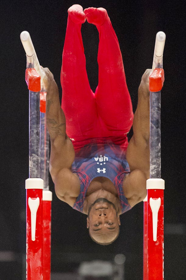 Donnell Whittenburg appears to get crushed between the bars in the men's all-around final.