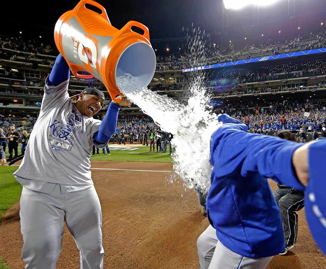 Salvador Perez of the Kansas City Royals dunks manager Ned Yost after winning the World Series in five games.
