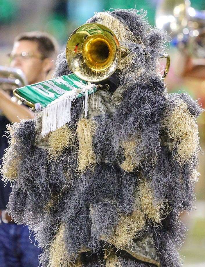 Members of the North Texas Mean Green band dress up for Halloween. North Texas defeateed UTSA 30-23.