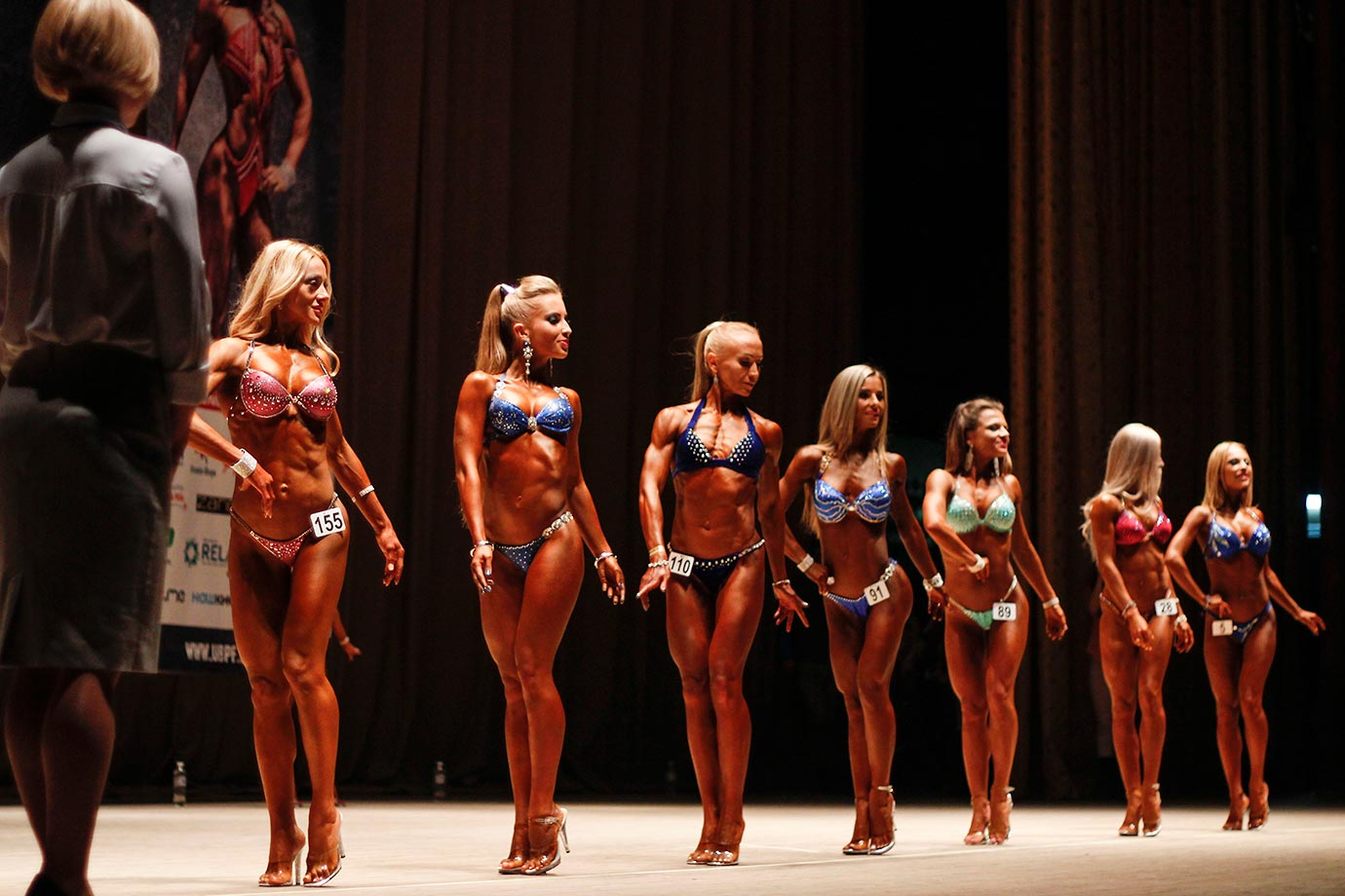 Body builders preparing backstage during the Bodybuilding Cup in Kiev, which includes classic bodybuilding, physicist and body fitness and bikini competition. We're guessing this is the bikini portion.