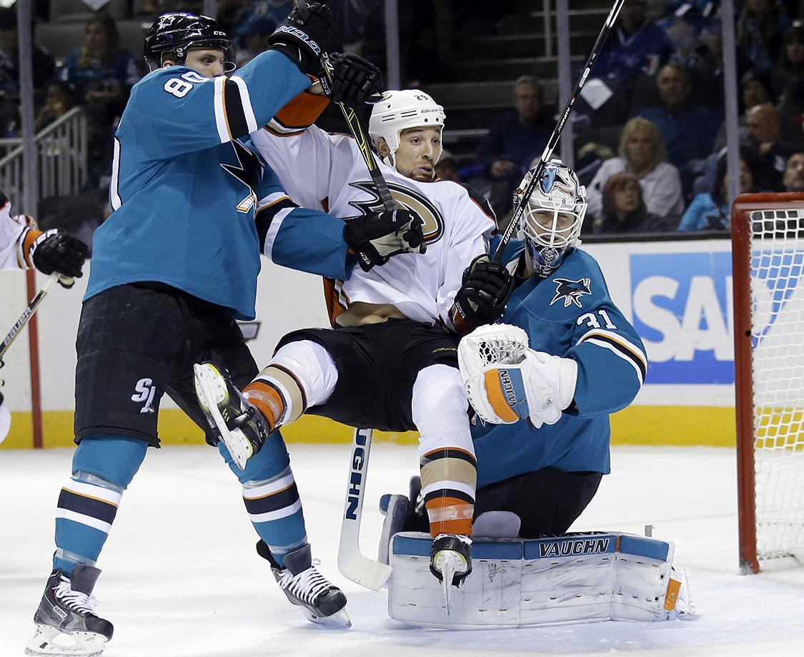 Chris Stewart of the Anaheim Ducks collides with Matt Tennyson and goalie Martin Jones of the San Jose Sharks.