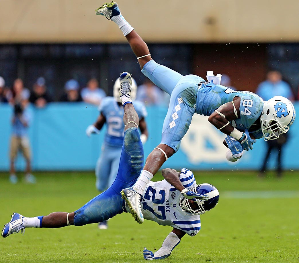 Bug Howard of North Carolina is upended as he catches a pass against Duke safety DeVon Edwards.