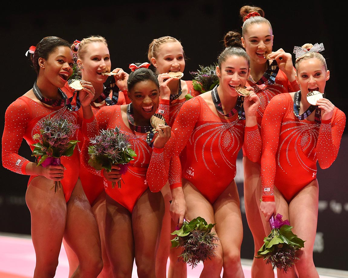 Team USA chews on its medals after the women's team final at the world gymnastics championships.