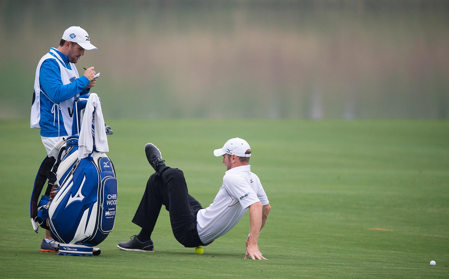 Chris Wood stretches during the BMW Shanghai Masters golf tournament.