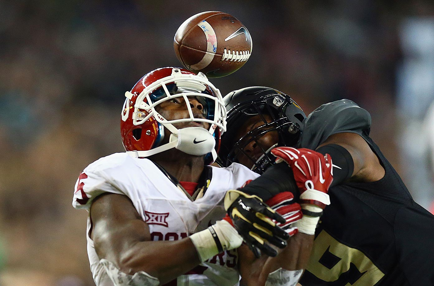 Ryan Reid of Baylor breaks up a pass intended for Durron Neal of Oklahoma.