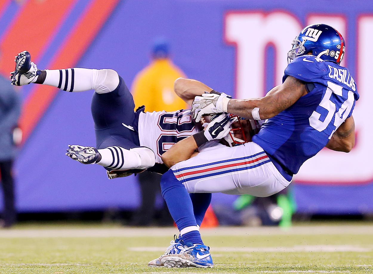 Danny Amendola of the Patriots is tackled by Jonathan Casillas of the Giants.