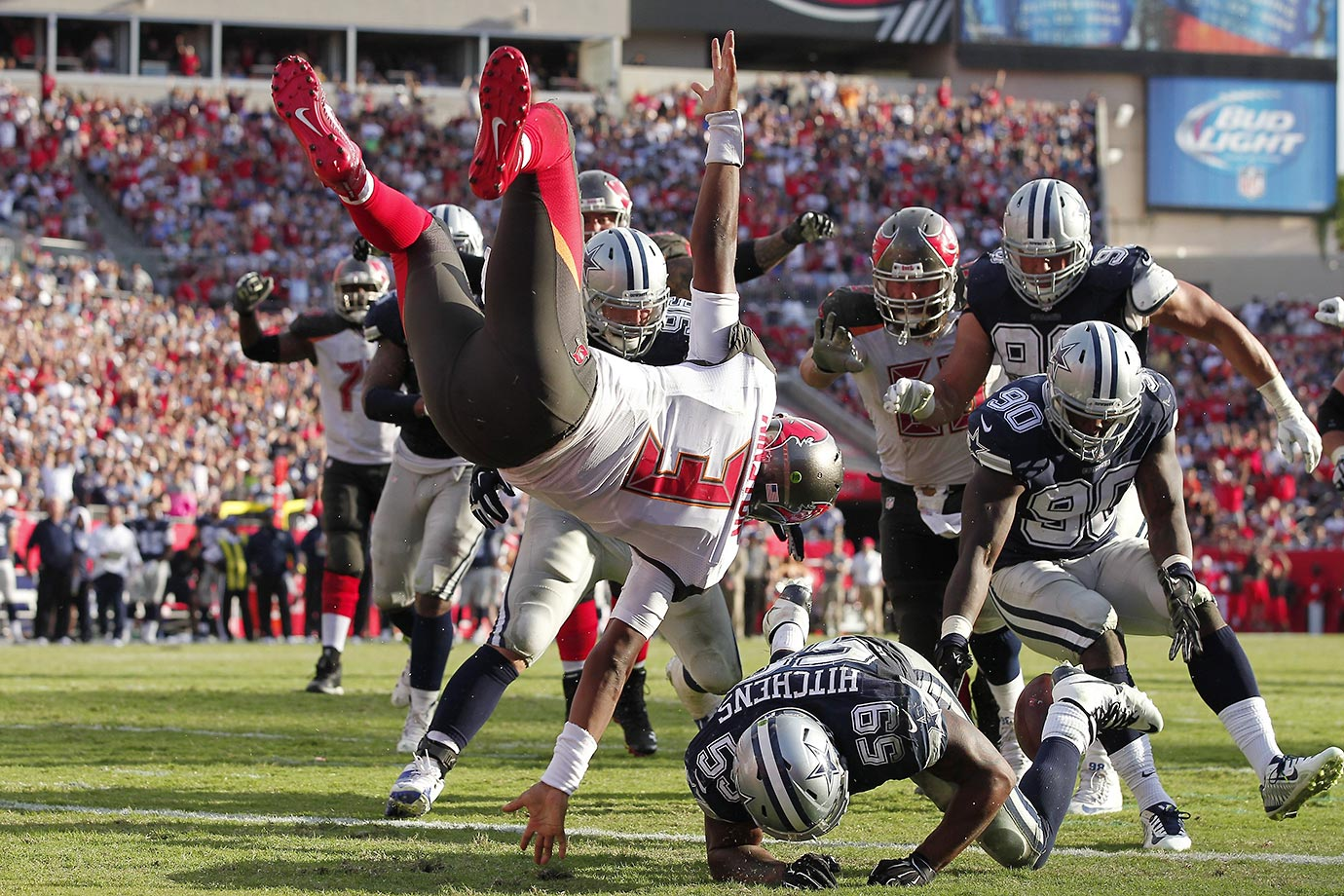 Jameis Winston of Tampa Bay loses the ball as he does a front flip when hit by Anthony Hitchens of the Dallas Cowboys. There was a penalty on the play, moving the ball to the 1.