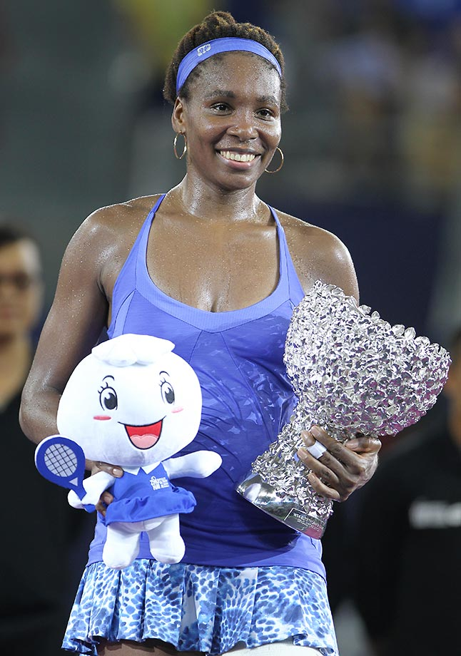 Venus Williams with the trophy (and stuffed toy) after winning the final match against Karolina Pliskova at the Huajin Securities WTA Elite in China.