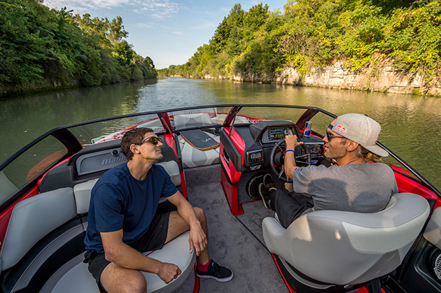 Andrew Pastura (L) and Brian Grubb (R) drive the boat down the Erie Canal in Lockport, New York.