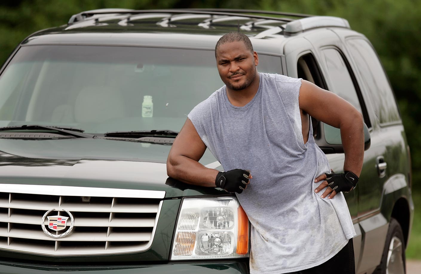 Walter Jones poses with his Cadillac Escalade, which he would push while exercising during the 2005 offseason.