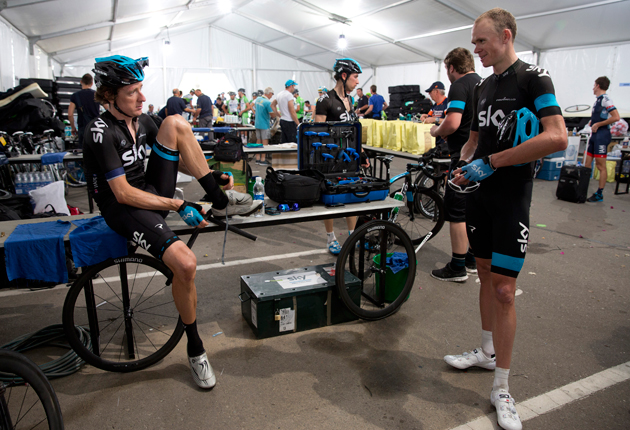 Sir Bradley Wiggins (L) chats with Chris Froome (R) ahead of stage two of the 2013 Tour of Oman from Fanja in Bidbid to Al Bustan in Muscat, Oman.