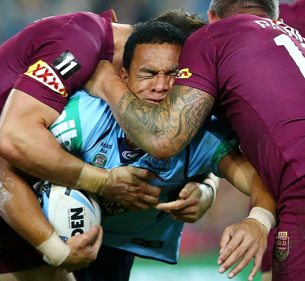 Will Hopoate of the Blues is tackled during the State of Origin series between the New South Wales Blues and the Queensland Maroons.