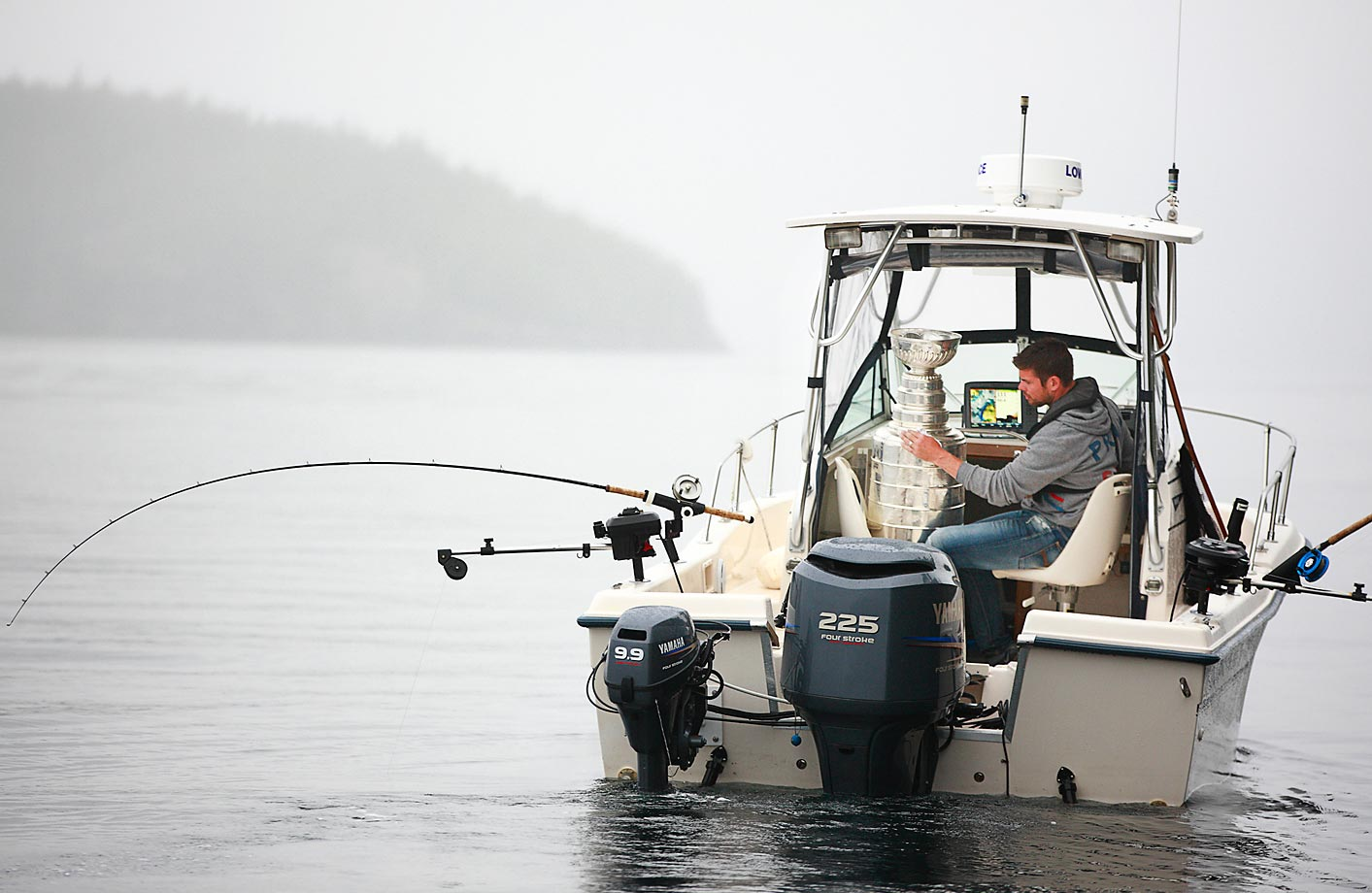 Willie Mitchell of the Los Angeles Kings goes fishing with the Stanley Cup in Telegraph Cove, British Columbia. Mitchell took the Stanley Cup to his hometown of Port McNeill, B.C. for his one-day celebration with the prized trophy.