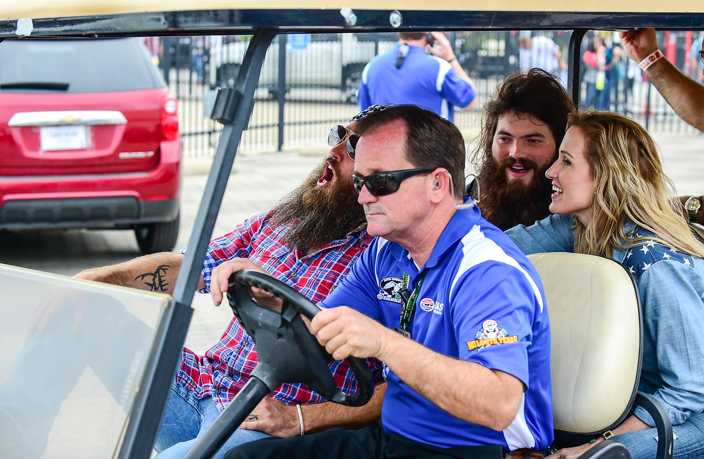 Willie, left, and Korie Robertson share a laugh on a golf cart while riding around the grounds at the Duck Commander 500 at the Texas Motor Speedway.