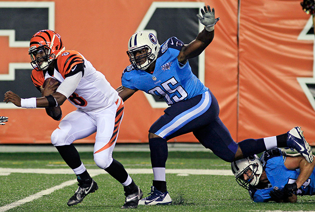 Cincinnati Bengals quarterback Josh Johnson (8) is pursued by Tennessee Titans defensive end Kamerion Wimbley (95) in the second half of a preseason game in Cincinnati, Saturday, August 2013.