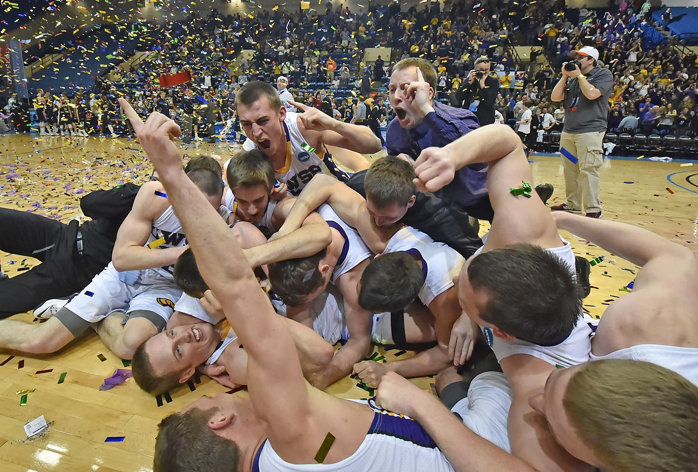 Wisconsin-Stevens Point players celebrate after defeating Augustana in a NCAA Division III college basketball championship game.