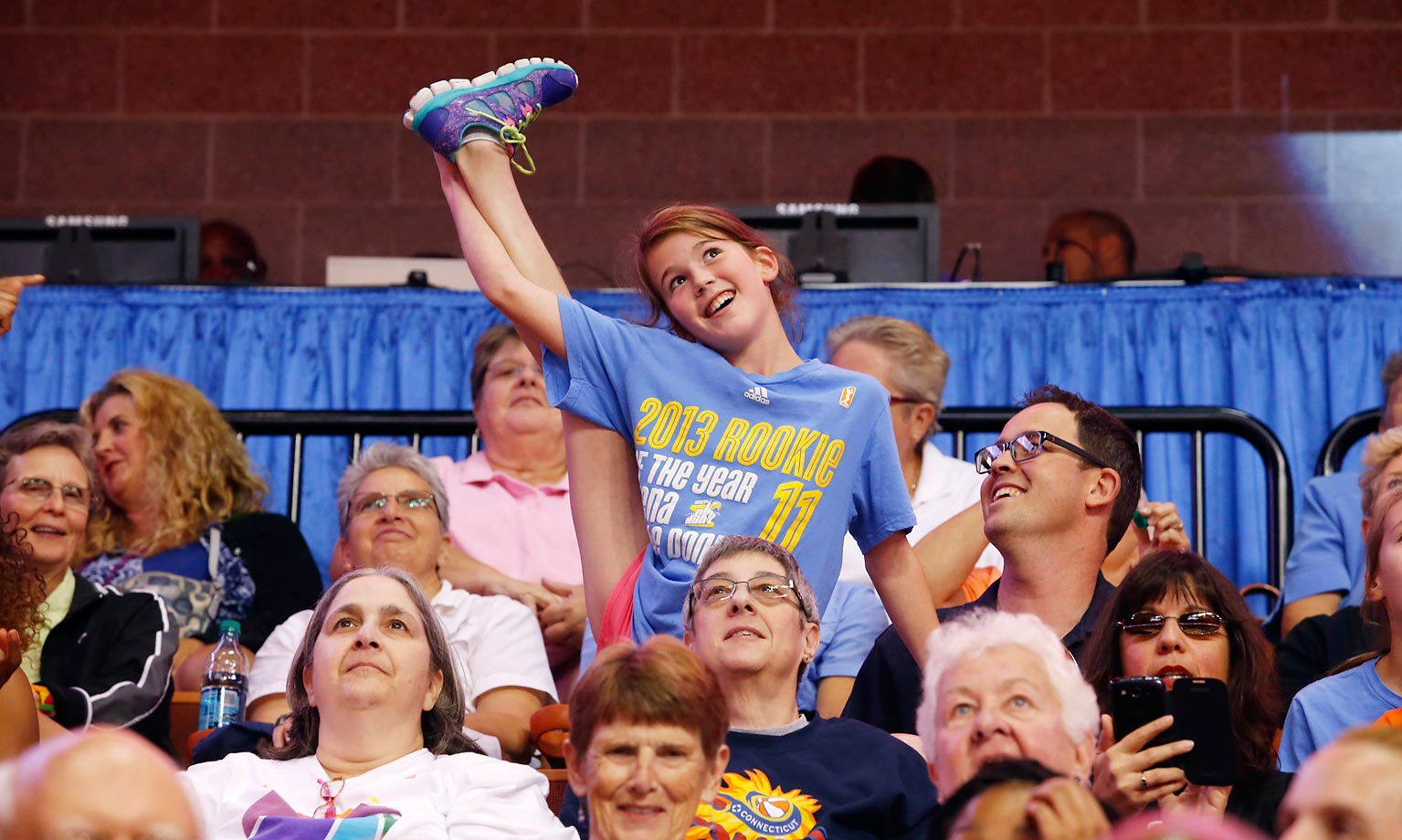 A fan cheers during the WNBA All-Star Game at the Mohegan Sun Arena in Uncasville, Conn.