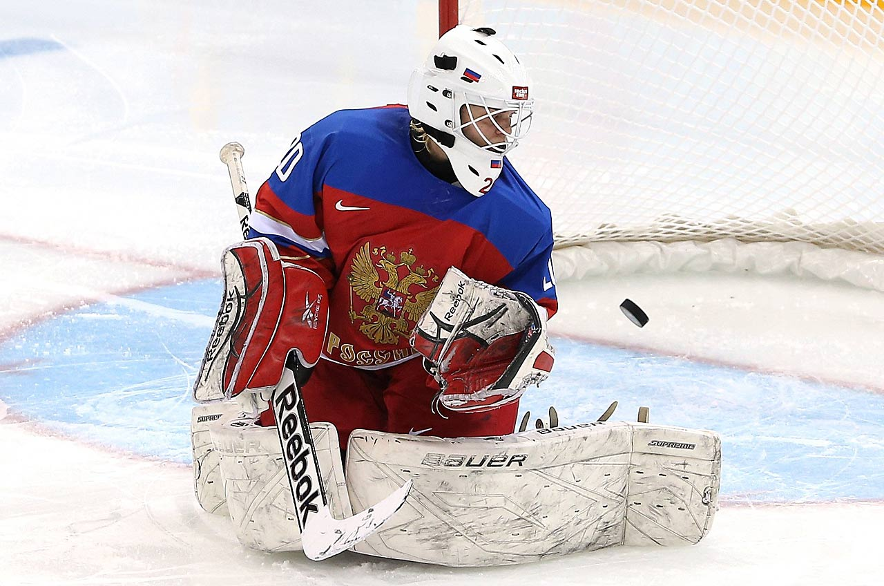 Yulia Leskina of Russia gives up a goal to Franziska Busch of Germany.
