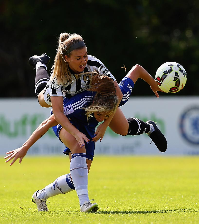 Gemma Davison of Chelsea Ladies and Sophie Walton of Notts County Ladies challenge each other for the ball during the FA WSL match in Staines, England.