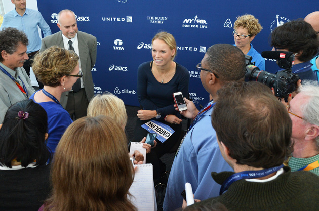 Wozniacki talks with reporters at the Jacob K. Javits Convention Center in anticipation for the NYC Marathon.