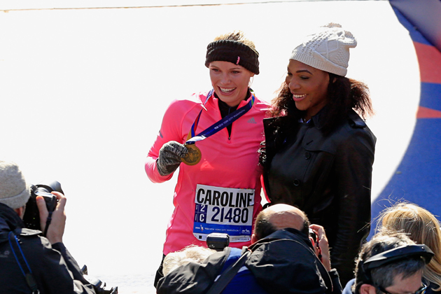 Wozniacki celebrates with Serena after finishing the 2014 New York City Marathon in November.