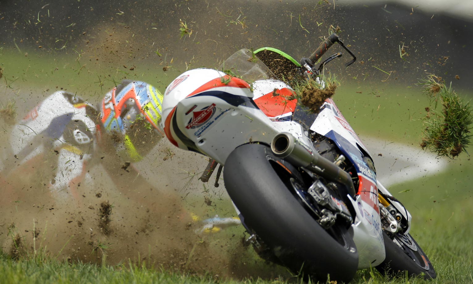 Xavier Simeon's bike keeps going after he crashed at the Indianapolis Moto 2 motorcycle race.
