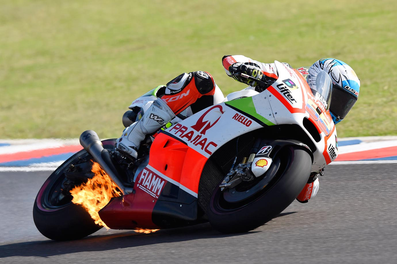 Flames on Yonny Hernandez's bike during the Moto GP race in Argentina.