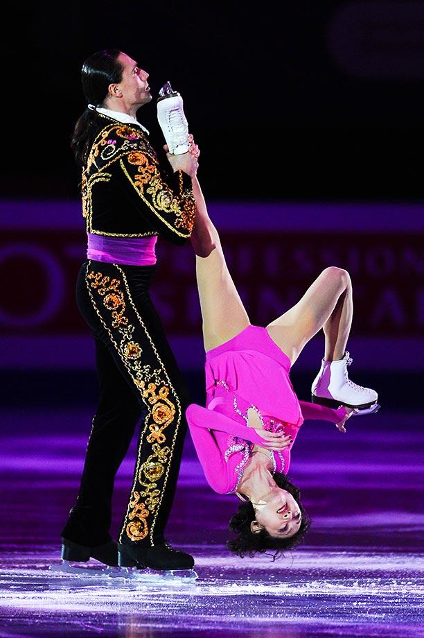 Yuko Kavaguti and Alexander Smirnov of Russia perform a pretty crazy maneuver at the ISU Junior & Senior Grand Prix of Figure Skating event.