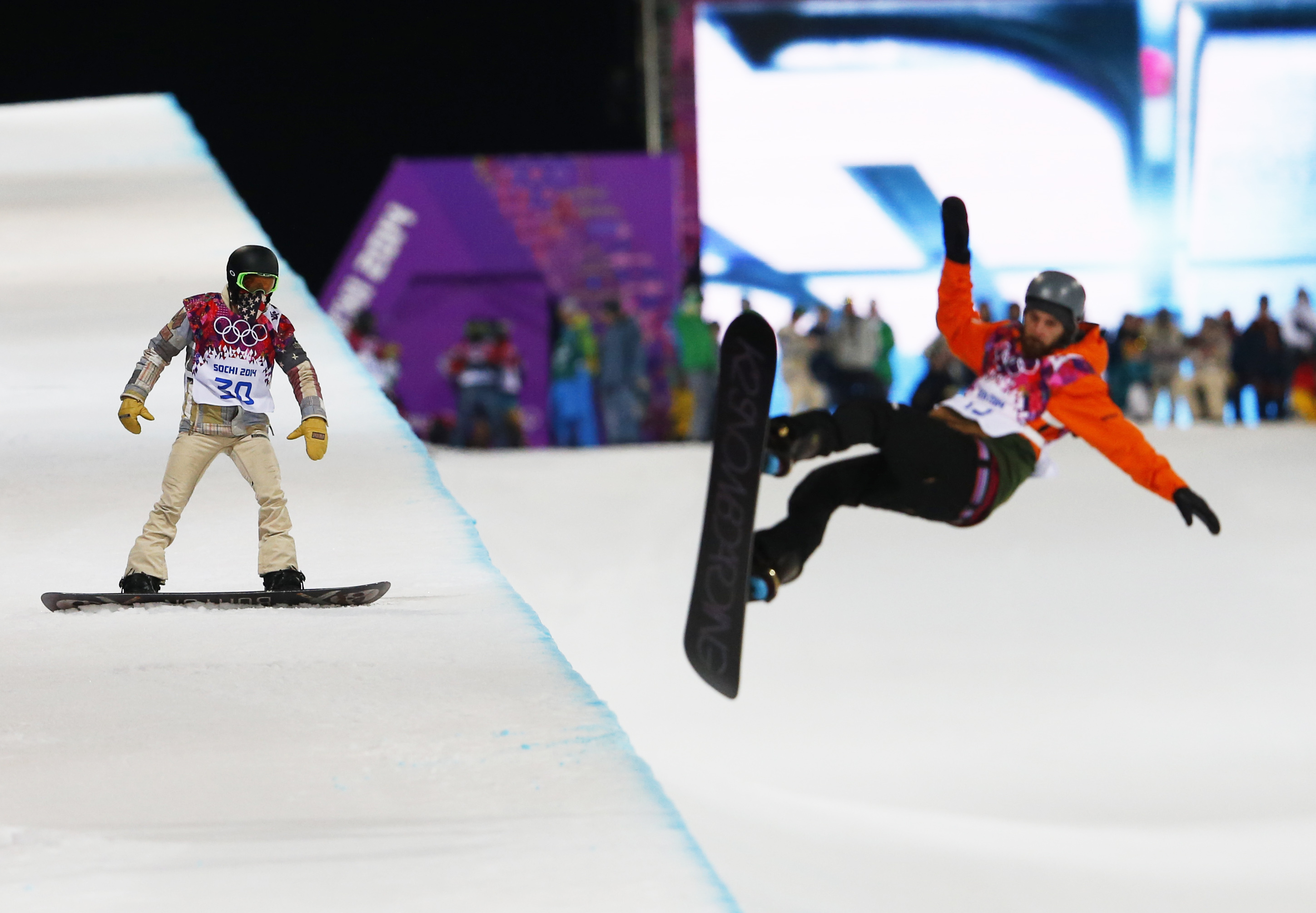 Shaun White of the United States waits on the edge of the half pipe during a snowboard half pipe training session.