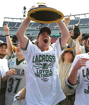 The Loyola (Md.) Greyhounds celebrate their first NCAA lacrosse championship. The team beat Maryland 9-3 in the finals.