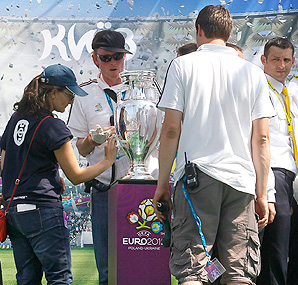 Feminist protesters from Ukraine tried to snatch the Euro 2012 trophy when it was put on public display.