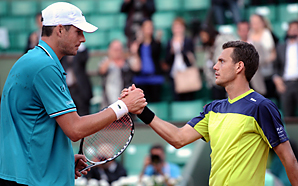 John Isner (left), seeded 10th, fell in five sets to Paul-Henri Mathieu.