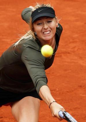 Maria Sharapova struggled with her serve but managed to hold off Klara Zakopalova to reach the French Open quarters.