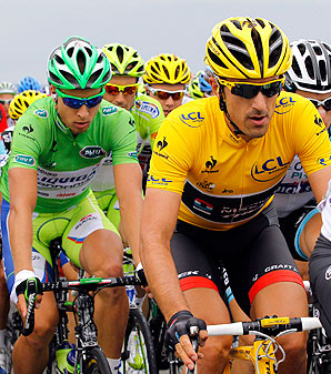 Fabian Cancellara, right, will wear the yellow jersey for one more day after maintaining his seven-second lead over Bradley Wiggins and Sylvain Chavanel.