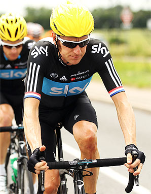 Bradley Wiggins is taking advantage of not holding the yellow jersey early on, conserving his and his team's energy.