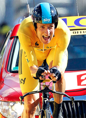 Bradley Wiggins completed the 25.8-mile time trial in 51 minutes and 24 seconds, extending his lead over defending champion Cadel Evans.