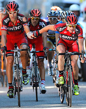 Cadel Evans (left) thanks teammate George Hincapie (right) as they finish stage 16. Evans fell to seventh place overall.