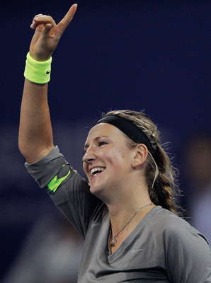 Victoria Azarenka claimed her fifth title of the season with a straight-set rout of Maria Sharapova at the China Open.
