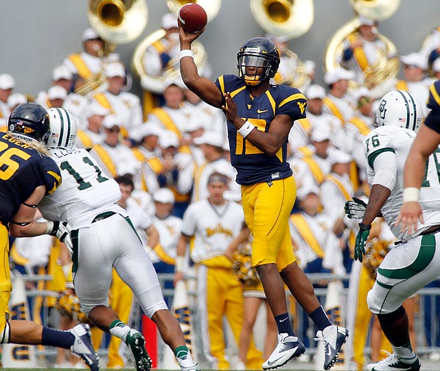 Mountaineers quarterback Geno Smith threw eight touchdown passes to lead his team to a 70-63 win over Baylor on Sept. 29. It was a sign of things to come for the Mountaineers, but in a bad way: the WVU defense went on to surrender 45+ points five more times, losing all but one of those games.
