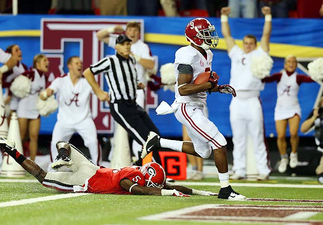 It's a game that will actually be talked about for ages. With a national title berth awaiting the winner, Alabama and Georgia played an uncharacteristically high-scoring SEC Championship, which made it all the more memorable. Alabama wide receiver Amari Cooper made one highlight reel catch, and eventually the game-clinching 45-yard touchdown reception with 3:15 remaining. Georgia quarterback Aaron Murray charged the Bulldogs 77 yards down the field in just over a minute, but his decision to not spike the ball proved costly in the end as wide receiver Chris Conley ended up with the ball in bounds as time expired. Alabama's 32-28 win guaranteed it a spot to play Notre Dame in the BCS National Championship.