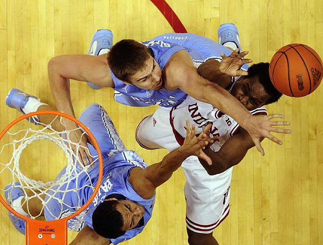 Hoosier guard Yogi Ferrell goes up for a shot against two Tar Heel defenders. No. 1 Indiana routed No. 14 UNC 83-59 in the ACC-Big Ten Challenge.