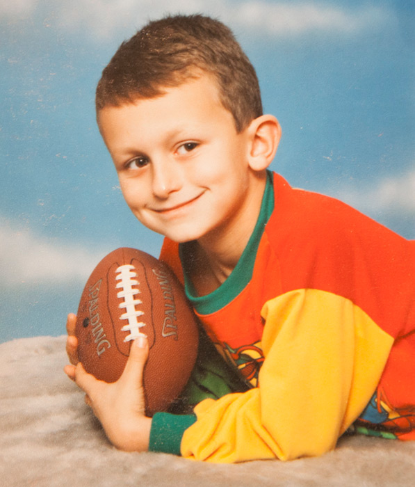 Manziel at 4 years old, already holding a football in his hands.