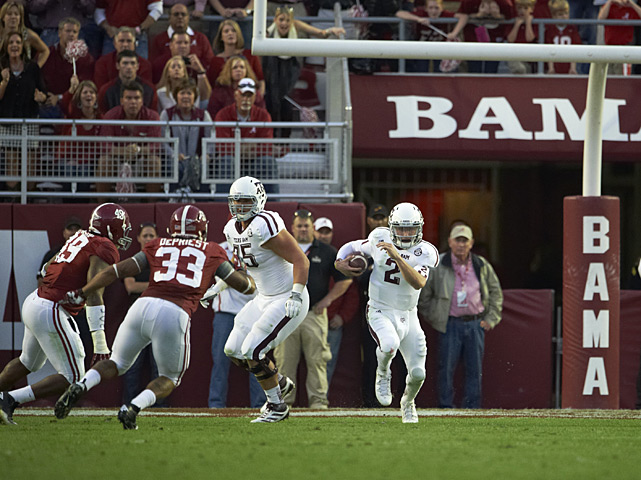 Manziel runs for a first down during the game against Alabama.