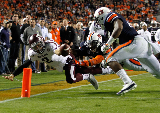 Manziel dives for a touchdown past Auburn linebackers Cassanova McKinzy and Daren Bates.