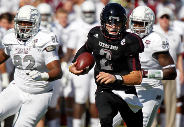Manziel runs past Mississippi State defensive lineman Kaleb Eulls for a touchdown in the second quarter of a November game against the Bulldogs.