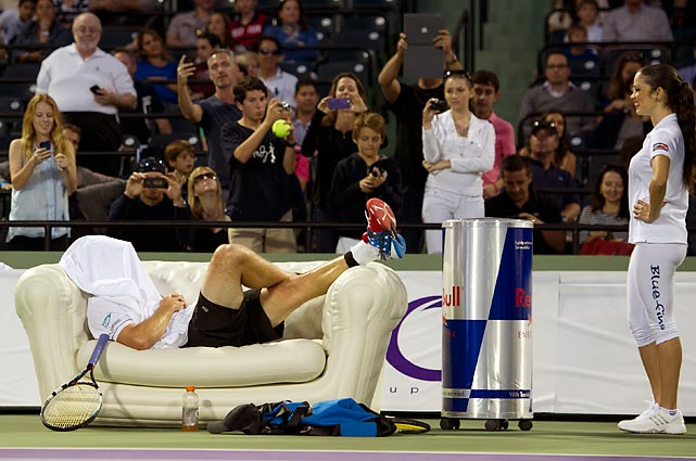 Shagged out after winning his friendly match against Andy Murray at the Miami Tennis Cup.