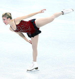 U.S. figure skater Ashley Wagner trails leader Mao Asada by half a point after the short program at the Grand Prix Final.
