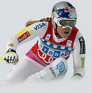 Lindsey Vonn timed 1 minute, 2.71 seconds to beat World Cup overall leader Tina Maze by 0.37 seconds.