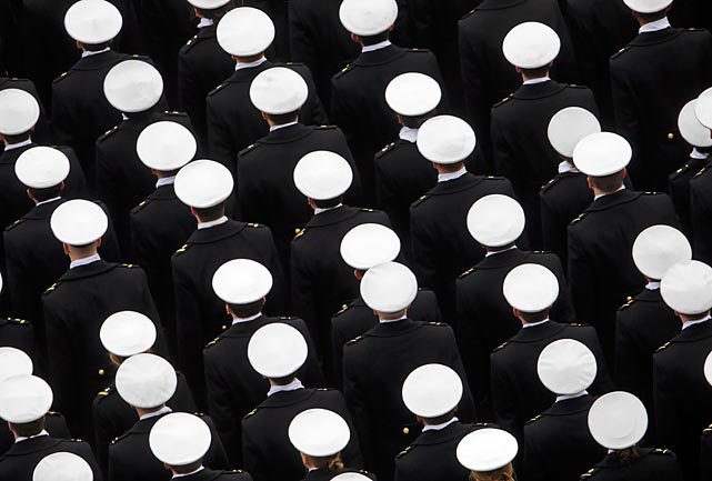 Navy Midshipmen march on the field in the lead up to the traditional Army-Navy game.