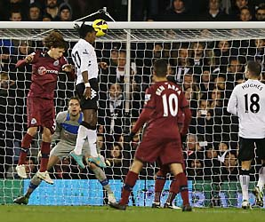 Hugo Rodallega heads home Fulham's second goal in a 2-1 win over Newcastle.